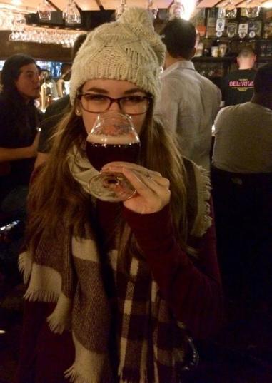 Drinking the famous Delirium beer at the Delirium Bar in Brussels, Belgium